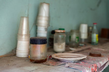 Dirty Shelf With Dishes In An Abandoned House