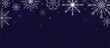 Christmas background decorated with snowflakes. White snowflakes on a dark background. Vector image.