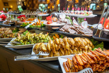 Close Up Of Foods With Plates In Buffet Of Restaurant.