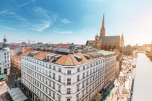 Aerial View Of The Roofs Of Houses And The Main Architectural Attraction Of Vienna - St. Stephen's Cathedral. Panorama Of The City Skyline