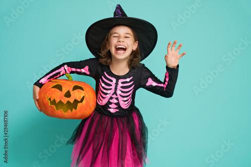 Obraz na plátně  little witch on turquoise background