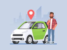 Carsharing. A Man With A Phone In His Hand Is Standing Next To A Car. Vehicle Rental