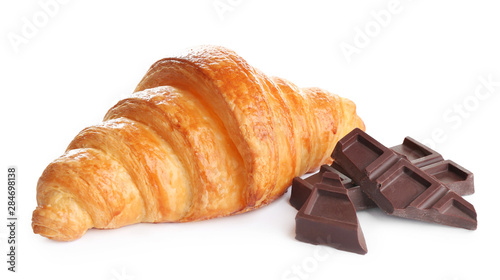Tasty croissant with chocolate on white background. French pastry
