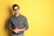 Young Man With Glasses On Yellow Background. Space For Text