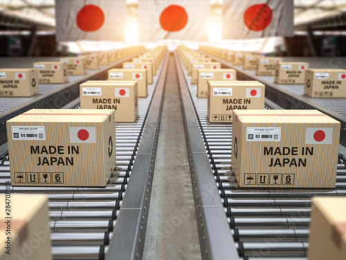 Made in Japan. Cardboard boxes with text made in Japan and chinese flag on the roller conveyor.