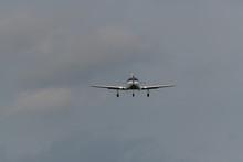 A Landing Plane On A Gray  Bac...