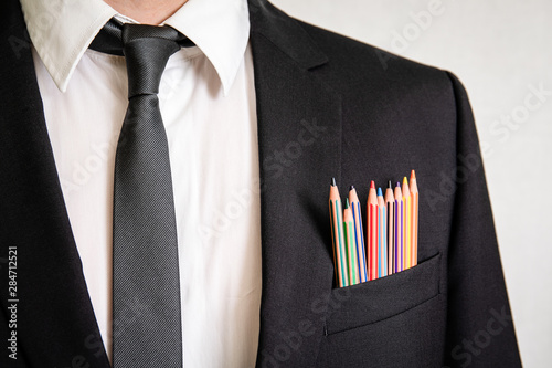 Fototapeta Man in a suit with pencils in front pocket. Business, office, skill, education and back to school concept obraz na płótnie