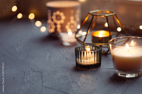 Keuken foto achterwand Vuur Hygge concept with candles and festive on the windowsill
