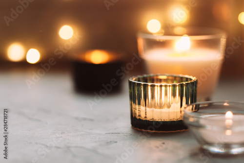 Hygge background with candles and bokeh of christmas garland Canvas Print