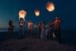 canvas print picture - Group of friends lighting lanterns