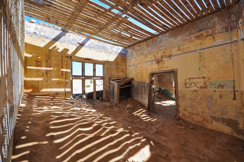 Inside an abandoned house in the mining ghost town of Kolmanskop in Namibia Canvas Print