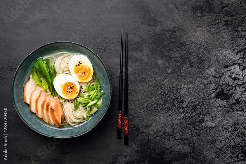 Japanese Ramen Noodle Soup With Chicken On Black Concrete Background Canvas Print