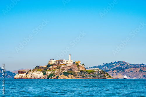 Fotografie, Obraz Alcatraz Prison Island in San Francisco Bay, offshore from San Francisco, California, a small island with military fortification and federal prison, now a famous national historical landmark
