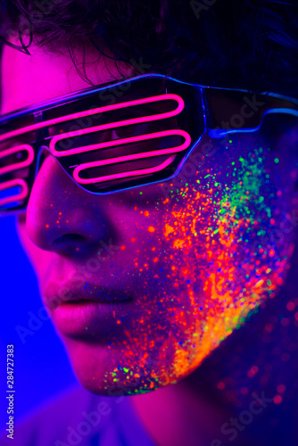 Fashion model with fluo painting on the face Wall mural