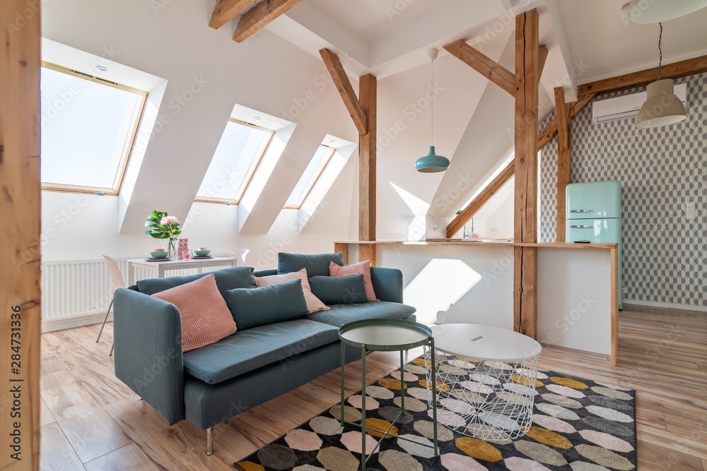 Fototapety, obrazy: attic living room with textile sofa and coffee table