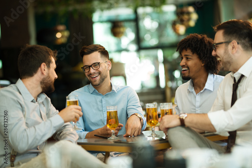 Fototapety, obrazy: Business people enjoy and work in a cafe and drink beer