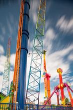 Long Exposure Photo Amusement Park Rides On Blue Cloudy Sky