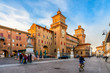 canvas print picture - Castle Estense (Castello Estense) and piazza Savonarola and monumet to Savonarola in Ferrara, Emilia-Romagna, Italy. Ferrara is capital of the Province of Ferrara