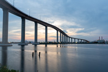 The Jordan Bridge Over The Elizabeth River On The Border Of Norfolk And Chesapeake Virginia Against A Beautiful Red, Purple, Pink, And Blue Sunset