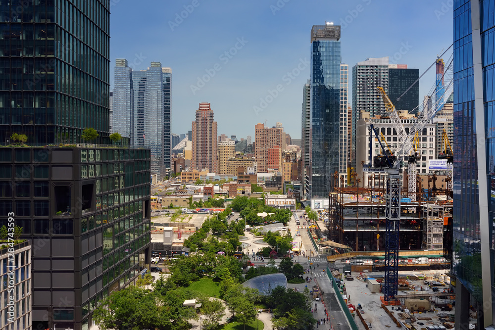 Fototapety, obrazy: New York, USA - July 9, 2019: View of New York from a famous Vessel, designed by architect Thomas Heatherwick, at the Hudson Yards district in Manhattan on summer day.