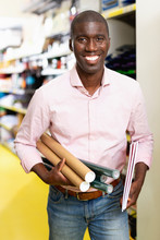 Cheerful African American Man Choosing Office Supplies At Stationery Department Of Supermarket