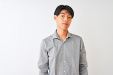 Chinese Businessman Wearing Elegant Shirt Standing Over Isolated White Background With Serious Expression On Face. Simple And Natural Looking At The Camera.