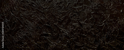 black-texture-background-panorama-in-the-form-of-a-black-textural-background-for-design-and-decoration-embossed-texture-of-a-wide-format