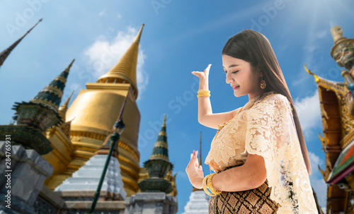 Beautiful Thai woman portrait dress up in traditional thai costume at Temple of the Emerald Buddha or Wat Phra Kaew in Bangkok, Thailand Wallpaper Mural