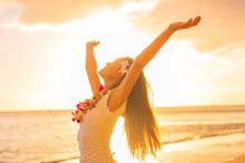 Hawaii Hula Dancer Woman Wearing Flower Necklace Lei On Sunset Beach Dancing With Open Arms Free In Sunset Relaxing On Hawaiian Travel Vacation. Asian Girl With Fresh Flowers Hair, Traditional Dance.