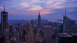 New York City skyline with urban skyscrapers at sunset. Time lapse, the flow of time.