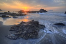Golden Rays Of Rising Sun Light Up The Sea Waves At A Beautiful Rocky Beach On Yilan Coast Near Taipei, Taiwan ~ Fascinating Sunrise Scenery At Ilan Seashore Under Dramatic Dawning Sky (Long Exposure)