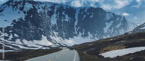 Norwegian highway road in the mountains covered with snow