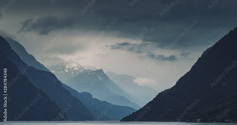 Fototapety, obrazy: Panorama of gloomy cloudy Norwegeian mountains and Hardanger fjord, Norway