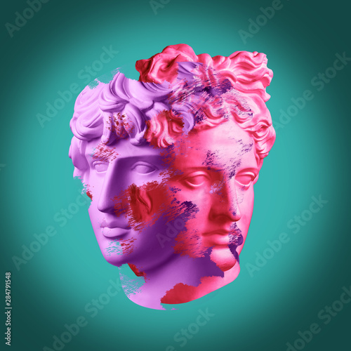 Photo Modern conceptual art poster with ancient statue of bust of Antinous and Apollo