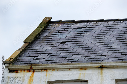 Photo Roof slates adrift and in need of repair