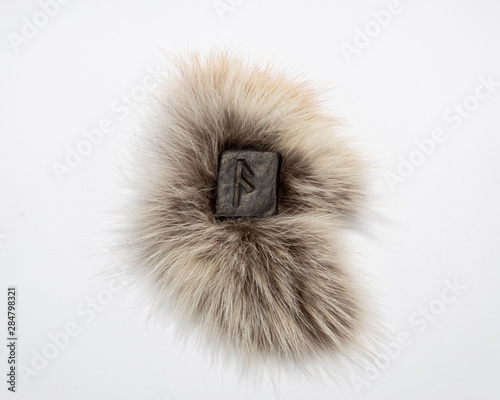 Photo  Norse rune Ansuz, isolated on fur and white background
