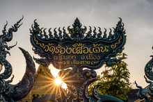 Sign Of Wat Rong Seur Ten Or Blue Temple In  Chiang Rai Thailand At Sunrise ,Thai Language.