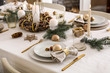 Leinwanddruck Bild - Beautiful table setting with Christmas decorations in living room