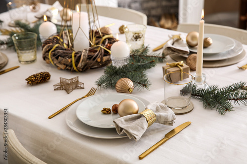 Beautiful table setting with Christmas decorations in living room - 284803351