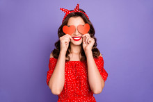 Pretty Lady In Playful Mood Hiding Eyes With Little Heart Figure Cards Wear Red Dress Isolated Purple Background