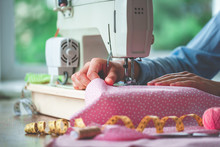 Electric Sewing Machine And Different Sewing Accessories During Sewing Process