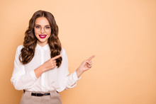 Portrait Of Her She Nice-looking Attractive Lovely Gorgeous Cheerful Cheery Confident Wavy-haired Lady Pointing Two Forefingers Aside Advert Ad New Novelty Product Isolated Over Beige Background