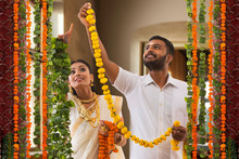 South Indian Couple Decorating Their Home For Onam