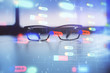Data tech hologram with glasses on the table background. Concept of technology. Double exposure.