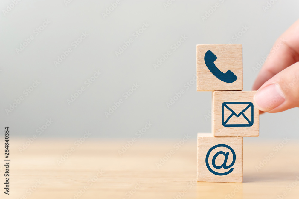 Fototapety, obrazy: Hand putting wooden block cube symbol telephone, email, address. Website page contact us or e-mail marketing concept