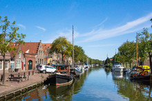 View Of Edam Netherlands With Canal, Boats And Traditional Architecture