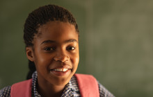 Portrait Of A Smiling Elementary School Girl
