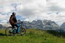 Man With Electric Bike, E-bike, Ebike, Looking Mountains Of Brenta Peak, Grostè Pass, Meadow, Dolomites, Madonna Di Campiglio, Summer, Sport, Adventure, Travel, Alps, Trentino Alto Adige, Italy