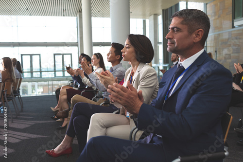 Business people applauding in a business seminar Canvas Print