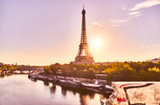 Fototapeta Fototapety z wieżą Eiffla - Blurred foto of Eiffel Tower from a less usual angle. Picture taken from the Bir-Hakeim Bridge